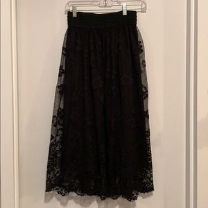 Black lace overlay midi skirt fits at the waist